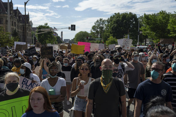 Protesters held signs protesting police brutality as they marched through downtown St. Louis on Monday.