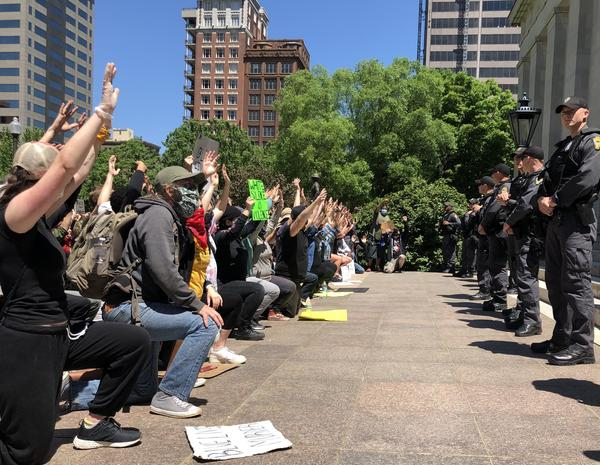 Demonstrators gather outside the Ohio Statehouse to protest the death of George Floyd and other black people by police.