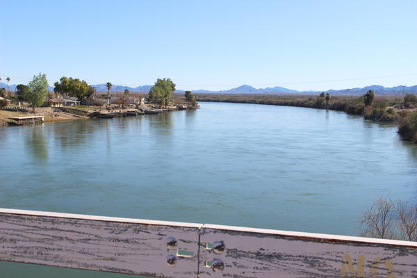 The Colorado River flows beneath Cibola Valley's Farmers' Bridge.