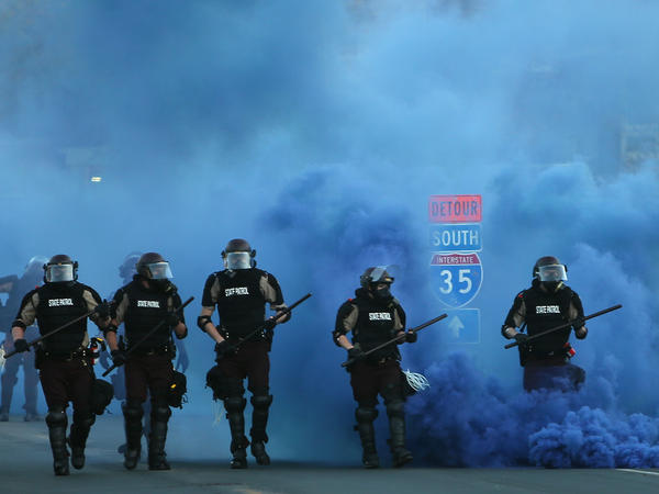 Police advance on demonstrators who are protesting the killing of George Floyd on May 30, 2020 in Minneapolis, Minnesota.
