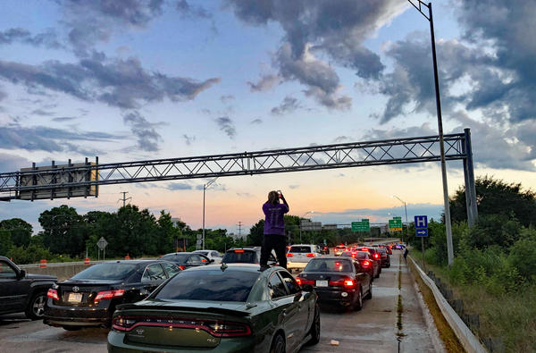 Protesters blocked traffic on Charlotte's I-277 briefly on Saturday.