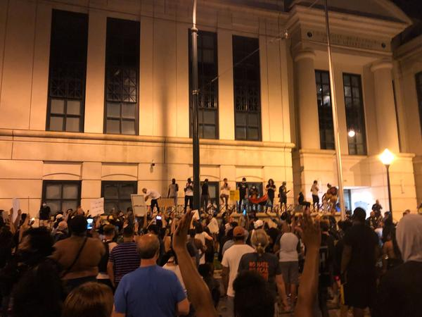 Protesters gathered outside CMPD headquarters in uptown Charlotte.