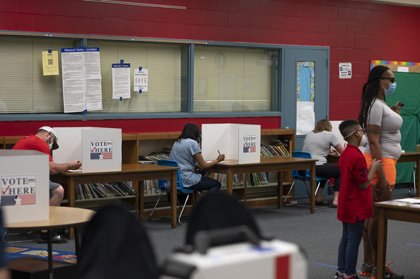 Ferguson residents vote at Griffith Elementary School in Ferguson. Residents voted in person for the first time since the onset of the coronavirus pandemic.