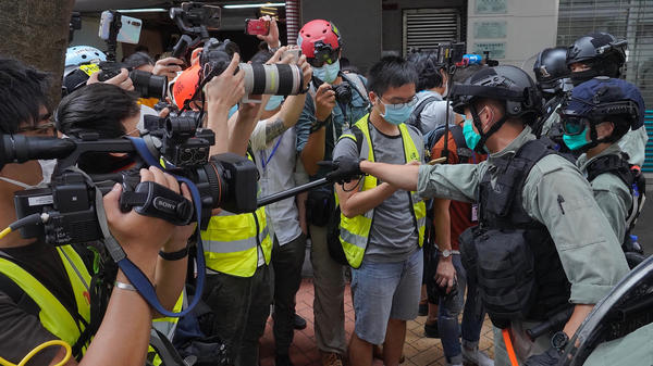 "Riot police clear away media gathered in Hong Kong last week ahead of debate on a bill that would criminalize abuse of the Chinese national anthem. China has accused the U.S. of ""double standards"" in its support for anti-China protests in Hong Kong and its criticism of Beijing's human rights record."