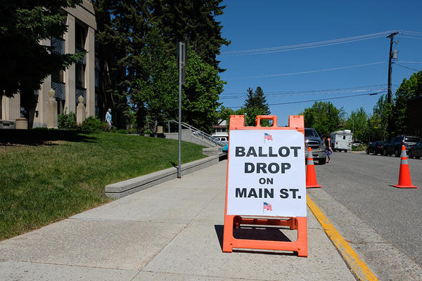 A sign in Gallatin County points voters to ballot drop off locations June 2, 2020