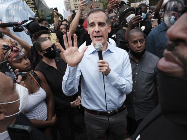 """""""We need to make a firm commitment to change, not just with words but with action,"""" Los Angeles Mayor Eric Garcetti said on Wednesday."""