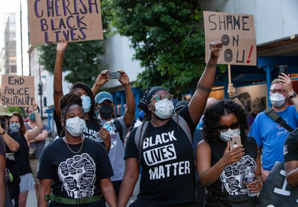 Demonstrators holding signs in support of Black Lives Matter movement during a protest outside the White House on the sixth consecutive day of protests over the death of George Floyd, an unarmed black man who died last week after being pinned down by a white police officer in Minneapolis.