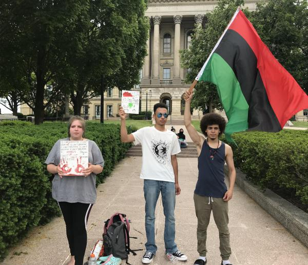 (from left to right) Haley Pate, Biron Butler and Korde Gardener at the Black Lives Matter protest in front of the Capitol on Wednesday.