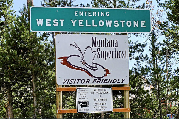 The entrace sign for West Yellowstone.