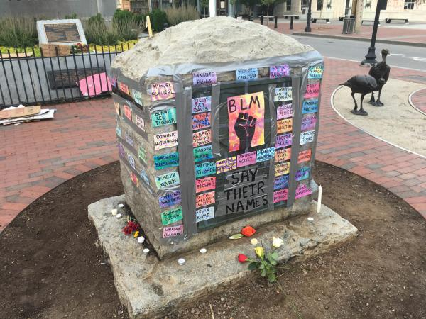 Protesters adorned a marker for Confederate General Robert E. Lee in Pack Square with names of African Americans killed at the hands of law enforcement