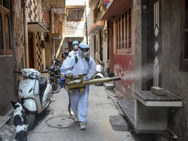 A volunteer sprays disinfectant after the Indian government eased a nationwide lockdown imposed as a preventive measure against COVID-19 in Amritsar, Punjab, on Thursday.