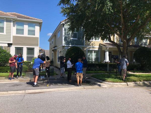 Protestors and media gather outside the Orlando townhome of former Minneapolis police officer Derek Chauvin. There are questions whether Chauvin voted illegally in Florida in 2016 and 2018.