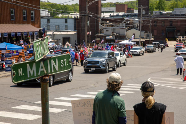 Supporters and opponents of President Trump meet in the small Maine town of Guilford Friday morning, ahead of Trump's visit.