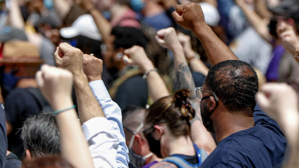 Demonstrators raise their fists during a May 30 march in Pittsburgh to protest the death of George Floyd.