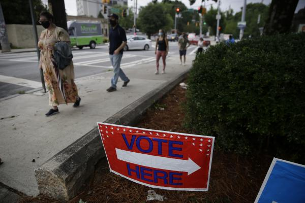 People wait in a line to vote in the Georgia's primary election in Atlanta on Tuesday, June 9. Long lines and equipment problems are hampering the twice-delayed primary.