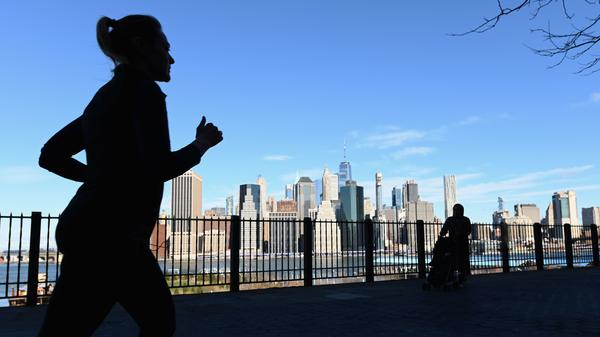 A woman jogging in New York City. NPR Music's Lyndsey McKenna has been running to relieve stress during the coronavirus pandemic.