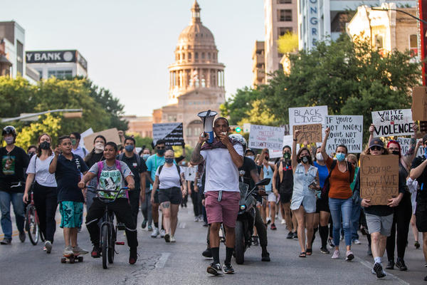 Protestors march from the State Capitol Building to Austin Police Department Headquarters in solidarity with nationwide demonstrations and protests decrying police brutality and in honor of George Floyd of Minneapolis and, locally, in honor of Mike Ramos.