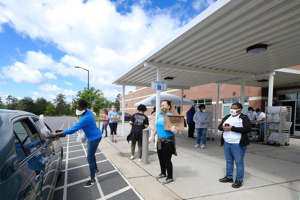 School meals have been done by drive-through since mid-March; officials hope to return to in-person classes in August.