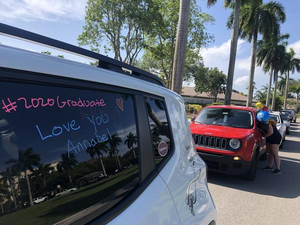 A congratulations message is scrawled on a car window for a surprise graduation parade honoring Annabel Claprood.