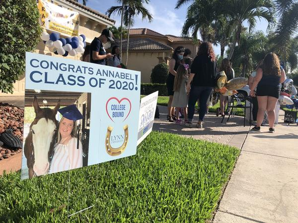 A sign congratulating Annabel Claprood on her graduation is in the lawn of her Coral Springs home.