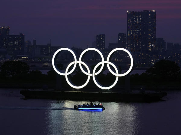 The Olympic rings float in the water at sunset in the Odaiba section in Tokyo earlier this month.
