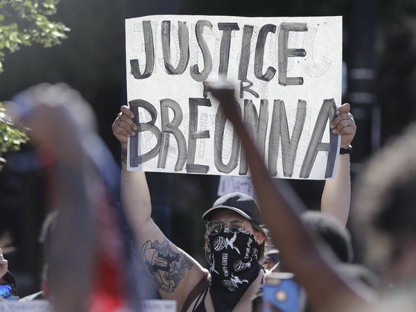 A protester holds a sign during a June 1 protest over the deaths of George Floyd in Minneapolis and Breonna Taylor in Louisville, Ky.