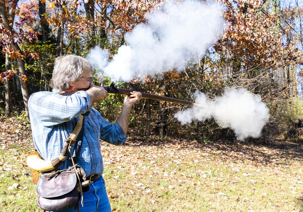 Larry Spisak shoots a Flintlock rifle. He has been making rifles for over 40 years.