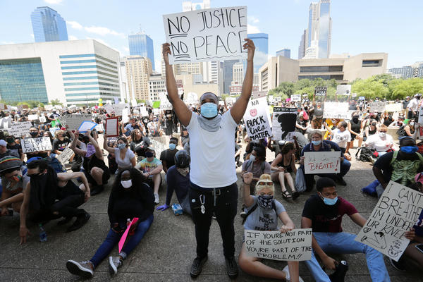 Protesters demonstrate police brutality in front of Dallas City Hall in downtown Dallas, Saturday, May 30.