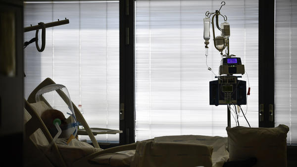 A COVID-19 patient lies in a hospital bed at Papa Giovanni XXIII hospital, in Bergamo, Italy, in April. Prosecutors are investigating whether regional or national authorities mismanaged the response to the coronavirus as it quickly spread through northern Italy.