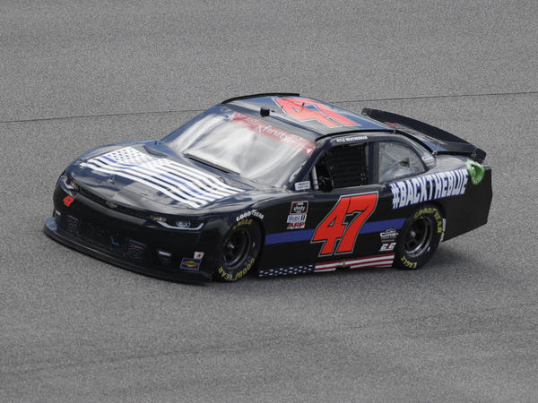 """The No. 47 car, driven by Kyle Weatherman, had a """"Blue Lives Matter"""" flag painted on its hood this weekend in Homestead, Fla."""