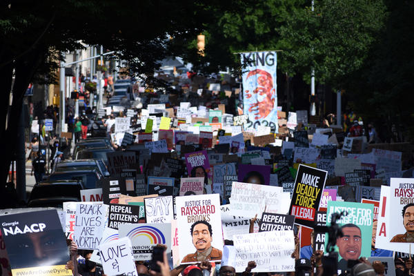 Protesters march against police violence in Atlanta on Monday. The event coincides with state lawmakers returning to work after the session was halted for three months amid concern about the spread of the coronavirus.
