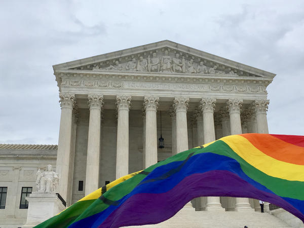 A rainbow flag flies in front of the Supreme Court building in Washington D.C. after SCOTUS hears arguments on LGBTQ employment rights, October 8, 2019.