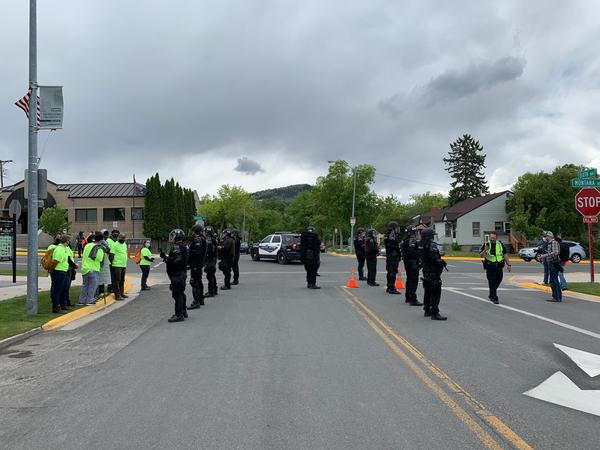 Helena law enforcement officers separate protesters and counter protesters at a Black Lives Matter protest June 14, 2020.