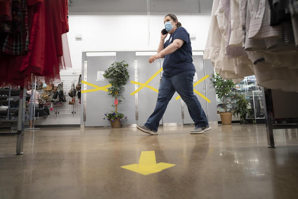 A MERS Goodwill employee walks the store soon after the business reopened in May.
