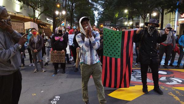 Protesters march in uptown Charlotte on Monday night. Demonstrations against systemic racism began here 16 days ago.
