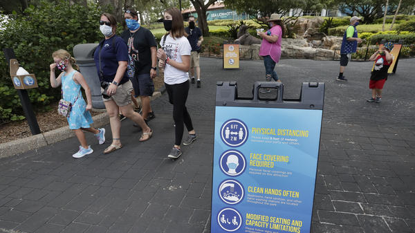 Signs remind guests of new safety measures in place at SeaWorld as it reopened on June 11 in Orlando, Fla. The park had been closed since mid-March to stop the spread of the new coronavirus.