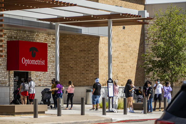 Shoppers line up to get into Barton Creek Square Mall in Austin after Texas allowed malls to reopen during the pandemic. Judge Nelson Wolff said in Bexar County he sees far fewer people wearing masks now, as COVID-19 cases and hospitalizations rise.