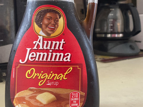 """""""We recognize Aunt Jemima's origins are based on a racial stereotype,"""" parent company Quaker Foods says, announcing plans to change the brand's logo and name."""