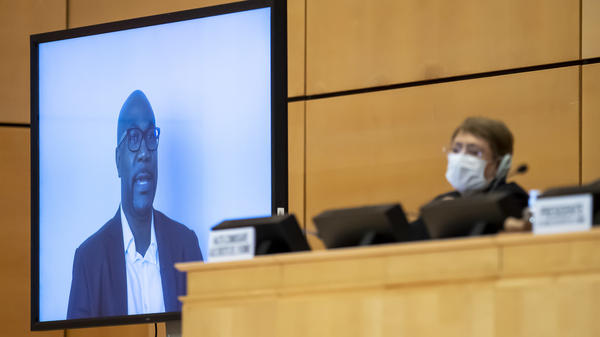 Philonise Floyd speaks via video to the U.N. Human Rights Council in Geneva on Wednesday, weeks after the killing of his brother George incited widespread protests against police brutality. U.N. human rights chief Michelle Bachelet looks on behind her face mask.