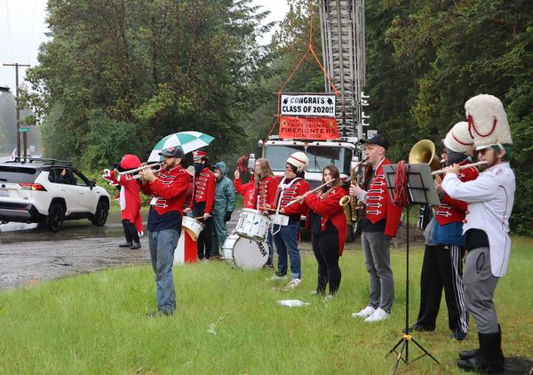 The Port Townsend High School pep band serenaded vehicles arriving at the local drive-in theater for the 2020 graduation ceremony.