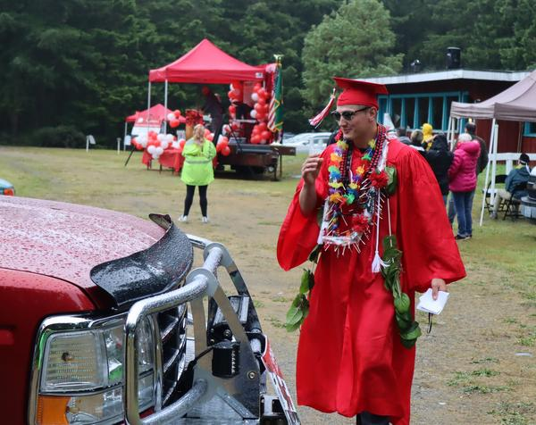 Senior class president Dylan Tracer returns to his family car after giving welcoming remarks at the Port Townsend High School graduation ceremony.