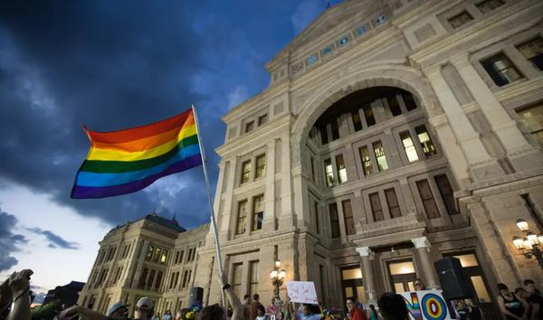 Members of Austin's LGBTQ community gathered on the steps of the Texas Capitol in 2017 to celebrate the anniversary of the 1969 Stonewall riots.
