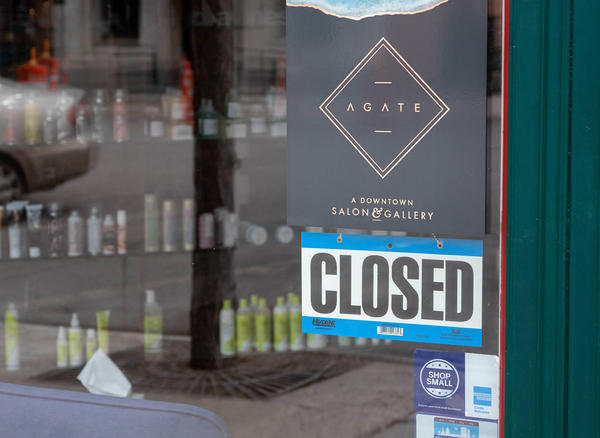 A 'closed' sign on the door of the Agate Salon in Missoula, April 03, 2020.