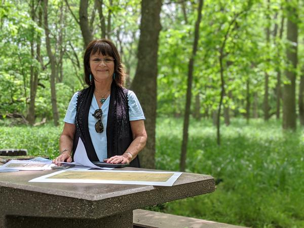 Pauline Sharp shows a map of Kanza land in the 1800s during a visit to Allegawaho Memorial Heritage Park.