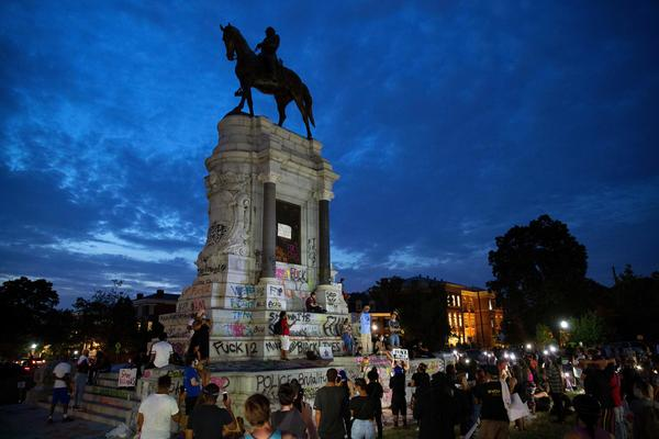 People gather around the Robert E. Lee statue on Monument Avenue in Richmond, Va., on June 4. Thursday a judge issued an indefinite injunction preventing the state from removing the statue.