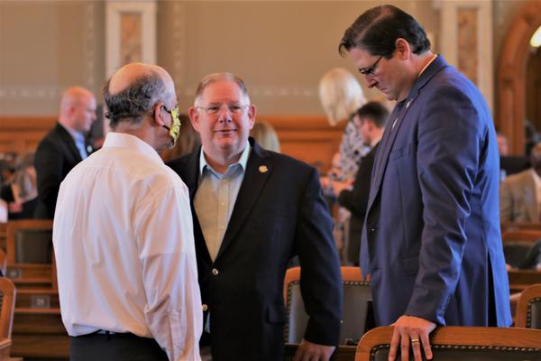 House Speaker Ron Ryckman (right), House Majority Leader Dan Hawkins (center), and House Minority Leader Tom Sawyer in the Statehouse earlier this month. All three are members of the panel that decides how to spend the federal aid.