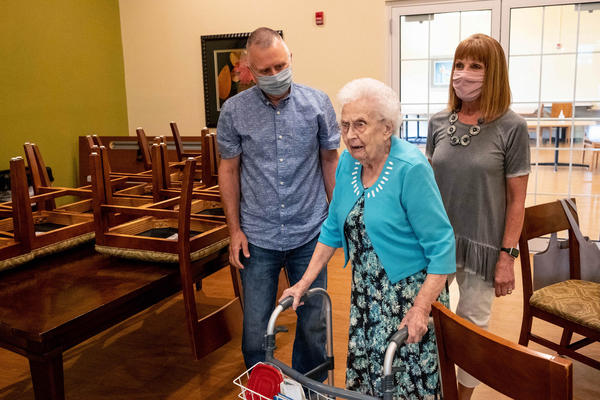 Mark and Janet Shaver assist Betty Shaver, 96, back to the door at the Mapleshire Nursing and Rehabilitation Center in Morgantown, W. Va.