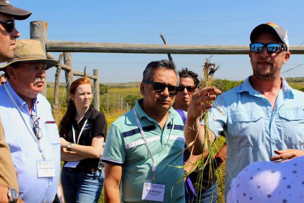Jesse Nippert, a plant biologist at Kansas State University, guides a crowd through the Konza Prairie.