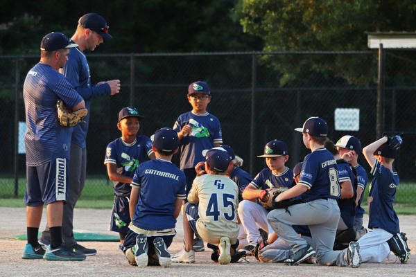 The 9U Gatorball baseball team takes a knee on the field after its practice at Jonesville Park in Gainesville on Tuesday, June 16, 2020.