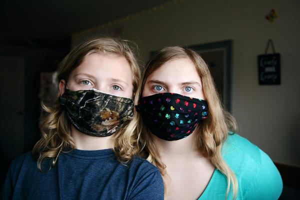 Some communities and businesses are requiring masks in certain areas as cases of COVID-19 climb around the country.
